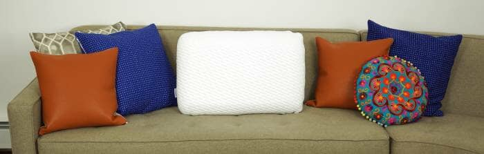 tuft & needle pillow displayed on a sofa