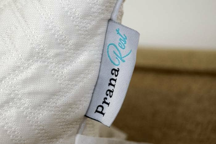 prana rest pillow tag with logo